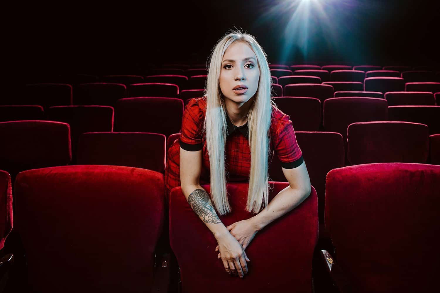 blonde girl movie theater red seats florida reperatory fort myers
