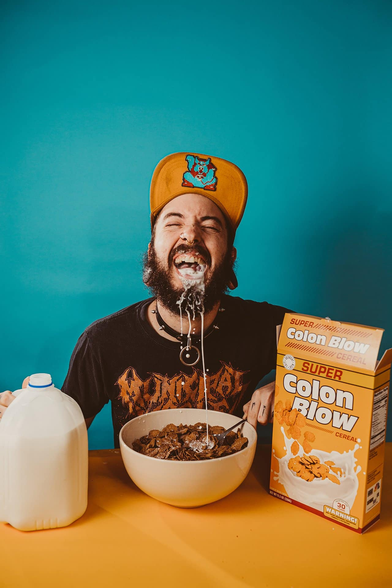rapper Duke Stamina eating cereal with teal and yellow colors