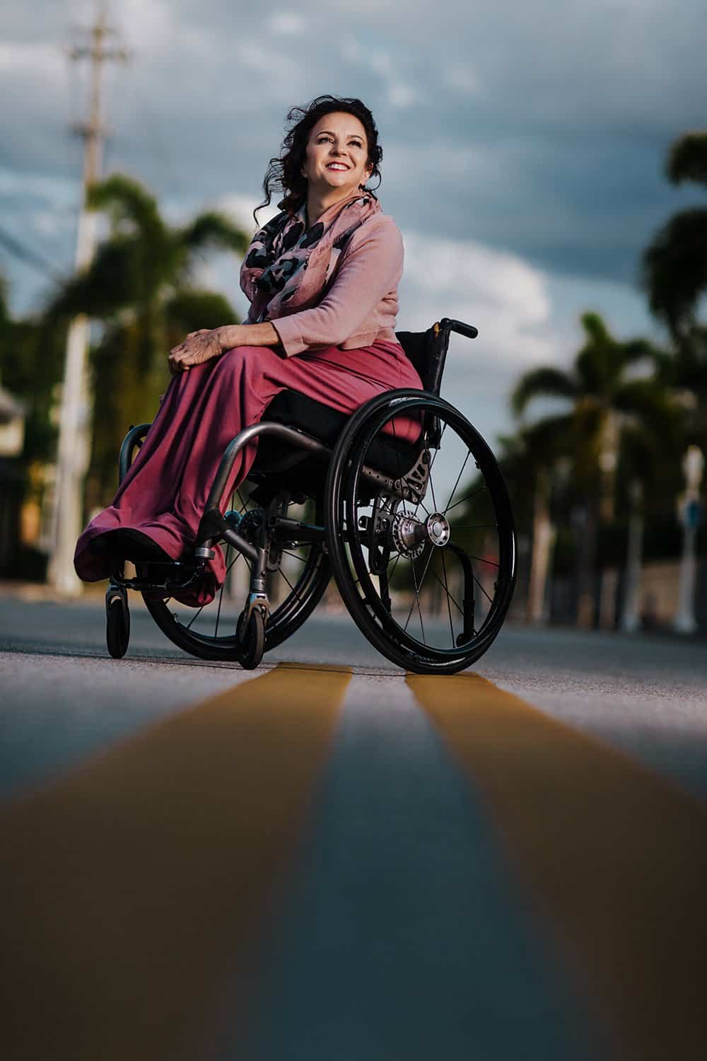 woman in wheelchair in downtown fort myers street jesi cason photography