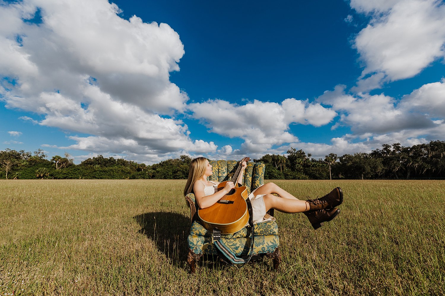 girl in a field acoustic guitar big sky florida
