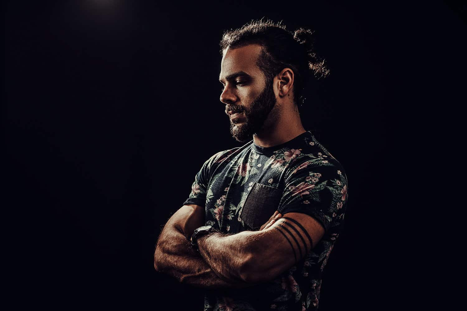 dark portrait of peter kolter wearing floral shirt and ponytail