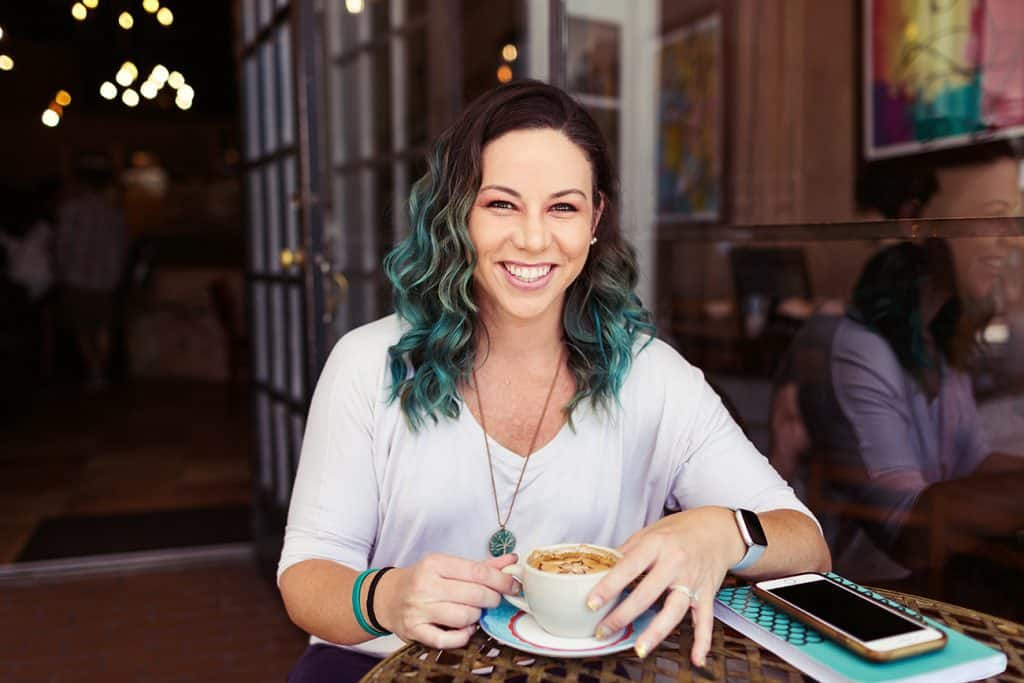 branding marketing photo of woman drinking coffee smiling