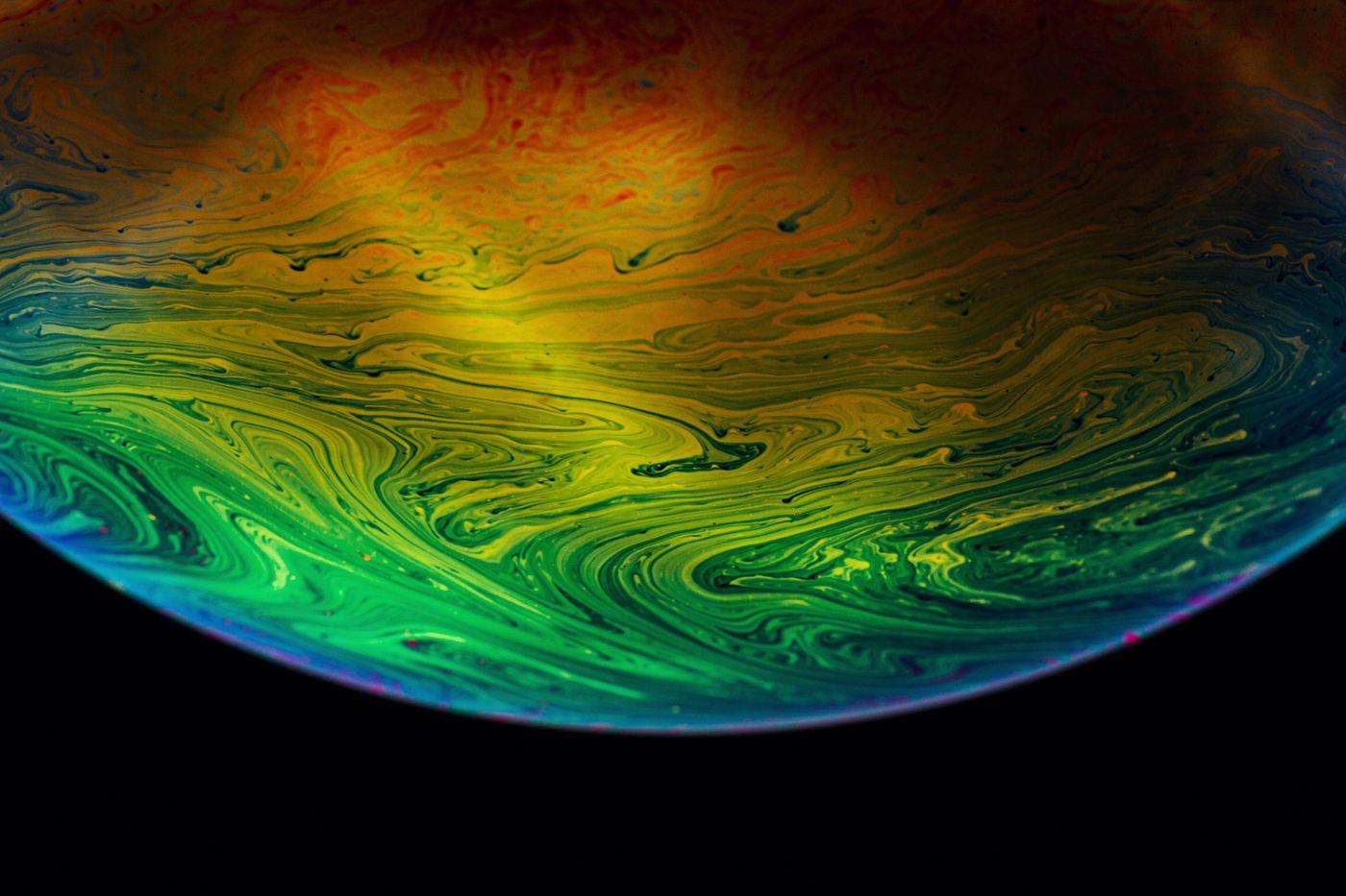 macro photography of soap bubble planet