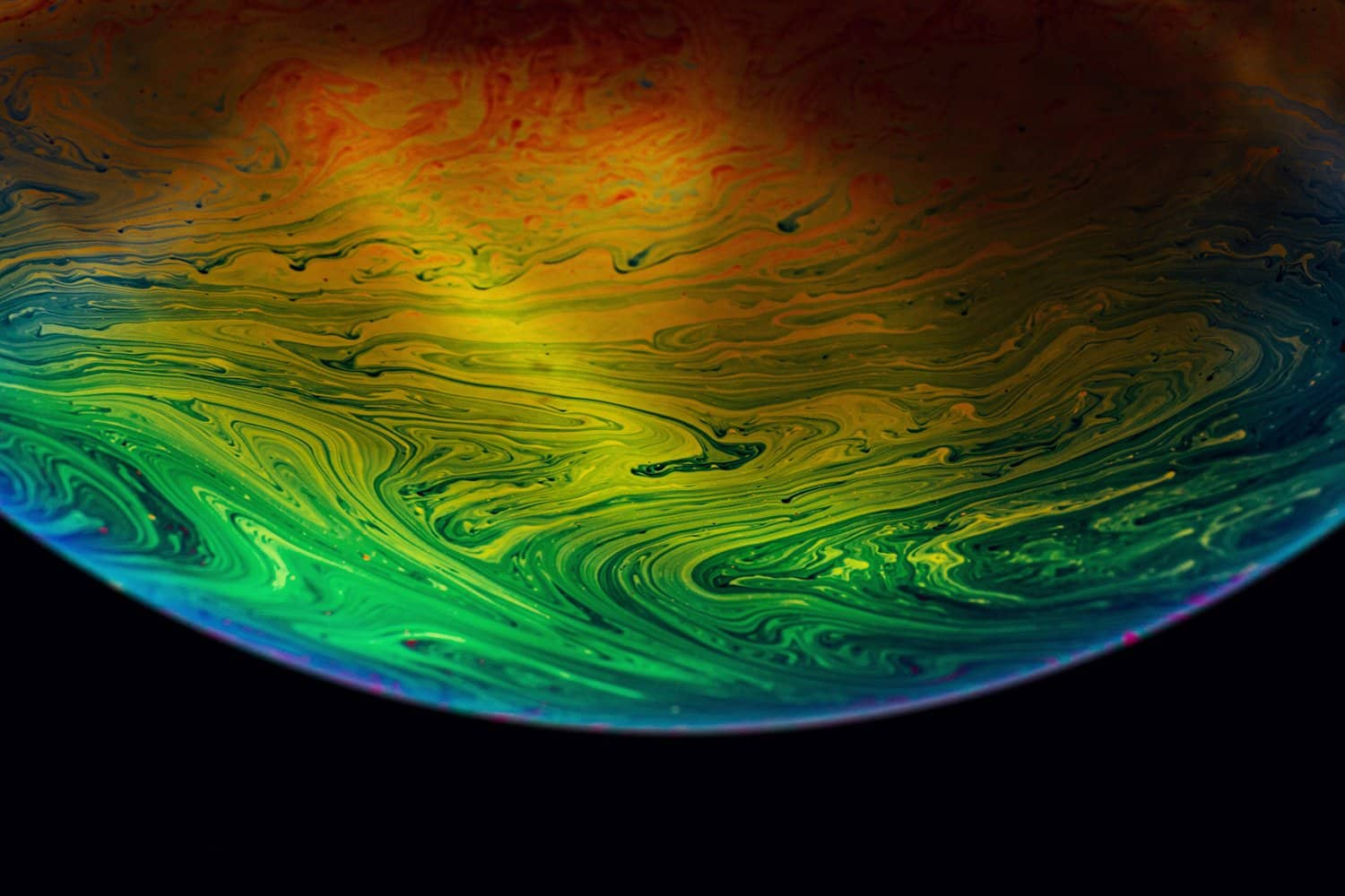 macro photography of soap bubble planet
