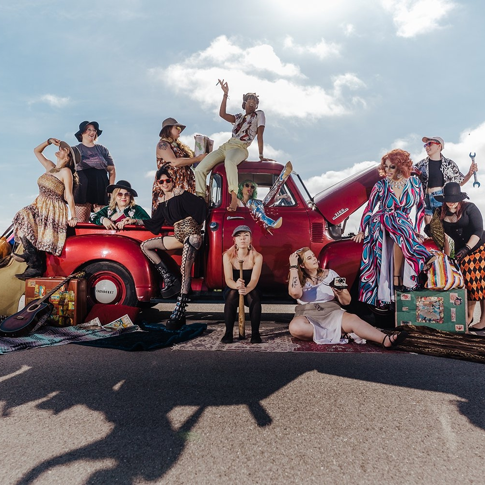 10 women working on a vintage truck