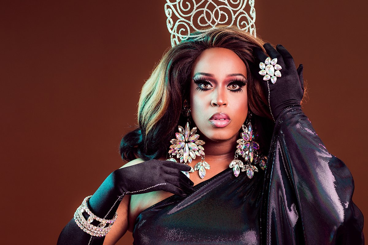 african american drag queen wearing crown