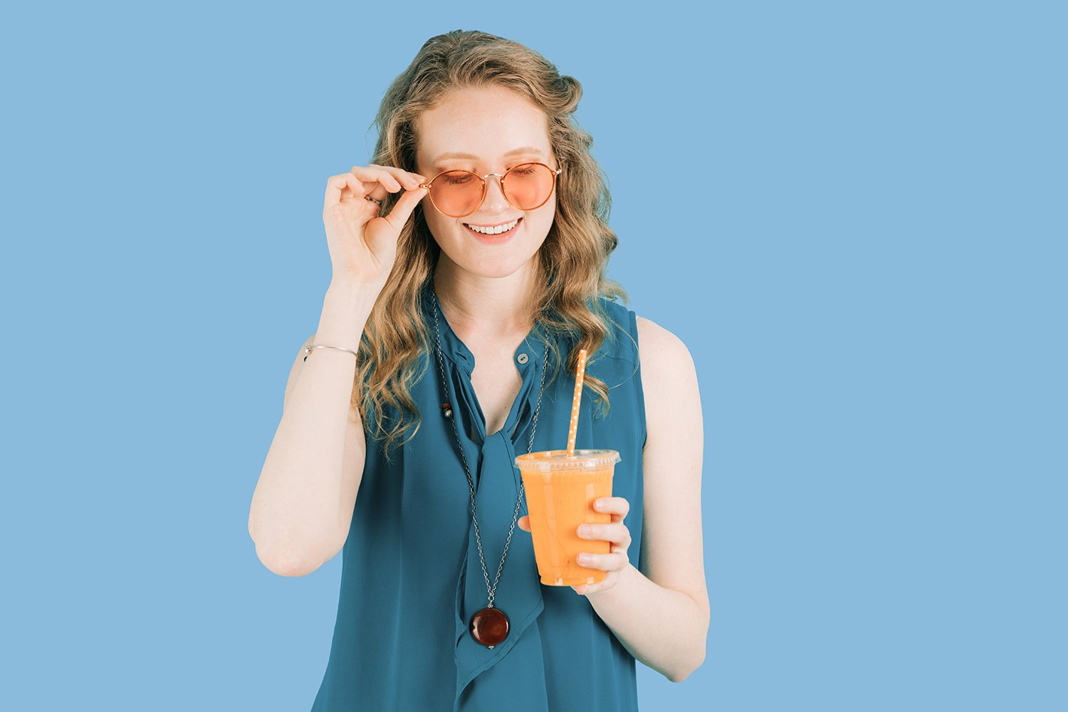 vegan woman with smoothie on branding blue background
