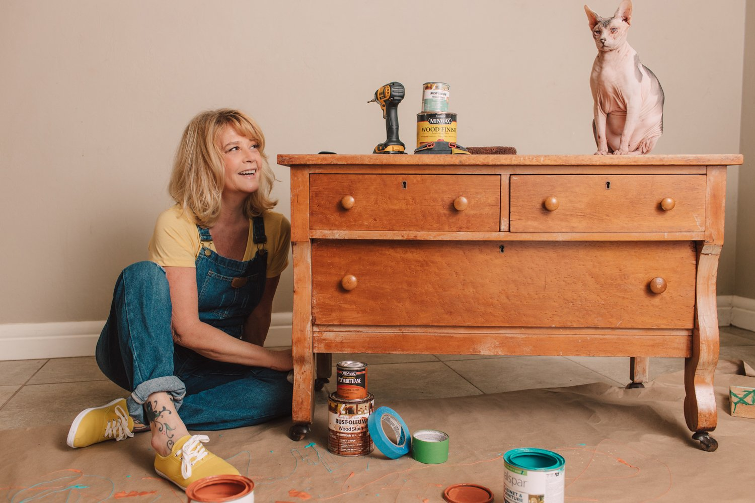 blonde woman painting furniture with hairless cat questions for branding photographer