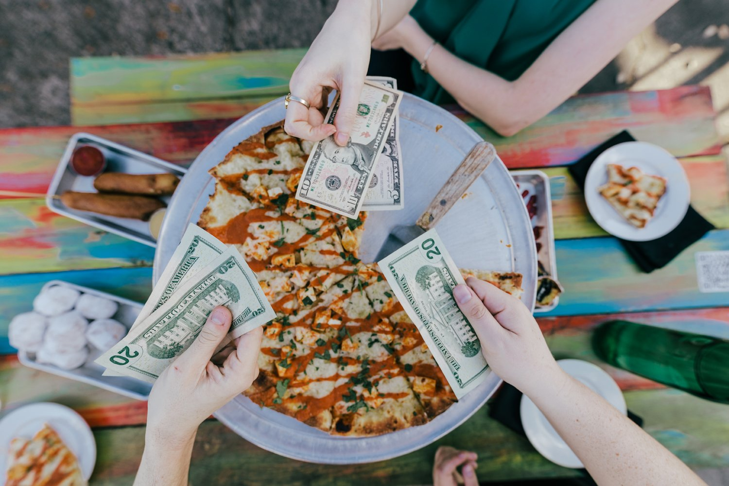 friends exchanging cash for pizza nice guys cape coral