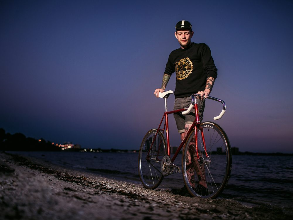 portrait of man with bicycle on fort myers beach
